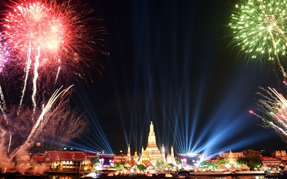 Fireworks light up the sky over Wat Arun (Temple of Dawn) during New Year celebrations in Bangkok on January 1, 2016. / AFP / CHRISTOPHE ARCHAMBAULTCHRISTOPHE ARCHAMBAULT/AFP/Getty Images