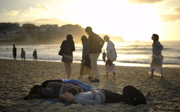 Visitors to Australia's Bondi Beach sleep after a night of celebrations as the first sunrise of the new year arrives in Sydney, January 1, 2016. REUTERS/Jason Reed