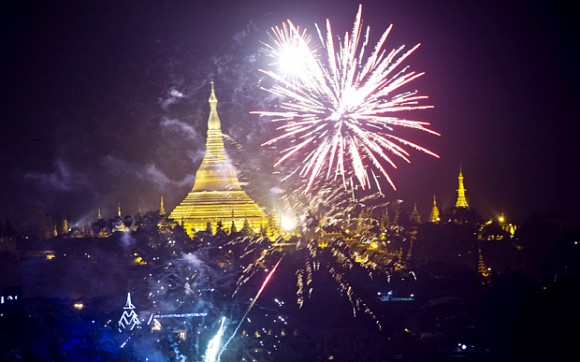 Firework are seen near the Myanmar landmark Shwedagon pagoda during the New Year countdown at the Kandawgyi Park in Yangon on January 1, 2016. / AFP / YE AUNG THUYE AUNG THU/AFP/Getty Images