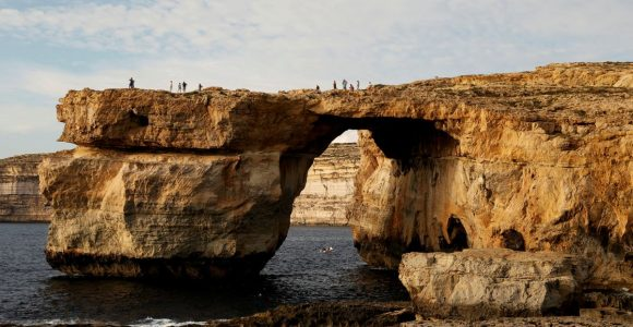 FILE PHOTO: Tourists walk on the Azure Window, a 50 metre high rock arch, at Dwejra Point cliffs on the west coast of the Maltese island of Gozo September 23, 2016. REUTERS/Darrin Zammit Lupi/File photo MALTA OUT. NO COMMERCIAL OR EDITORIAL SALES IN MALTA